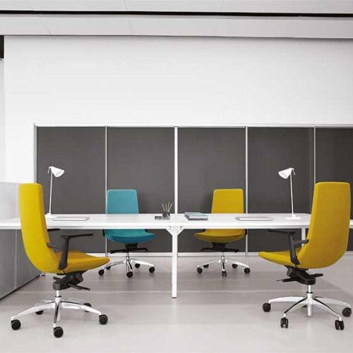 Nova U desks with chairs around them