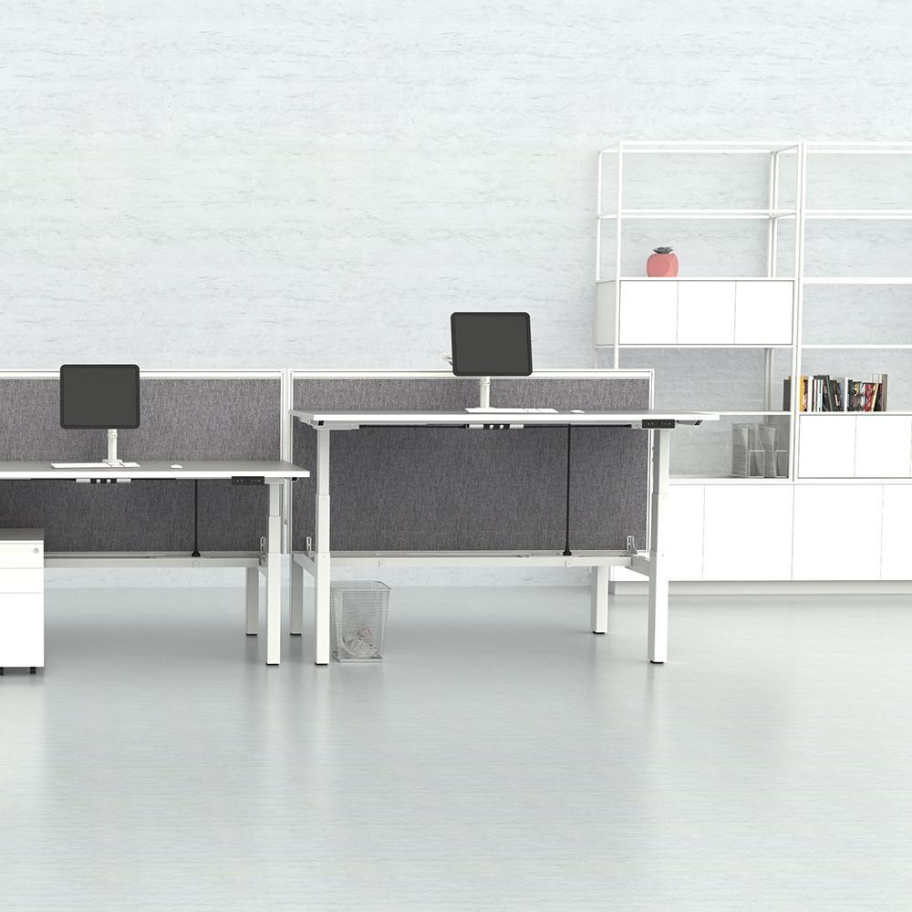 Travel-H-Frame-Workstation in an office. Sit stand desks