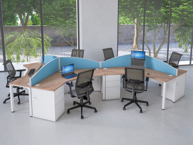 workstations arranged in office with blue desk screens