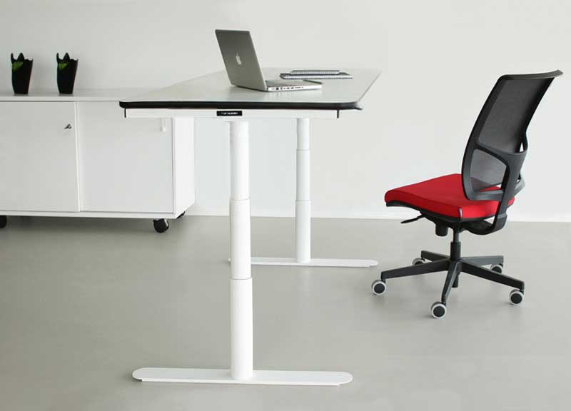 Diva swivel office task chair next to a desk in a modern office