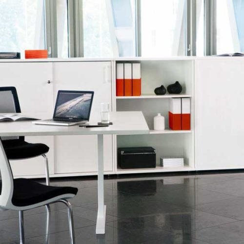 Eva chairs in modern office around a desk