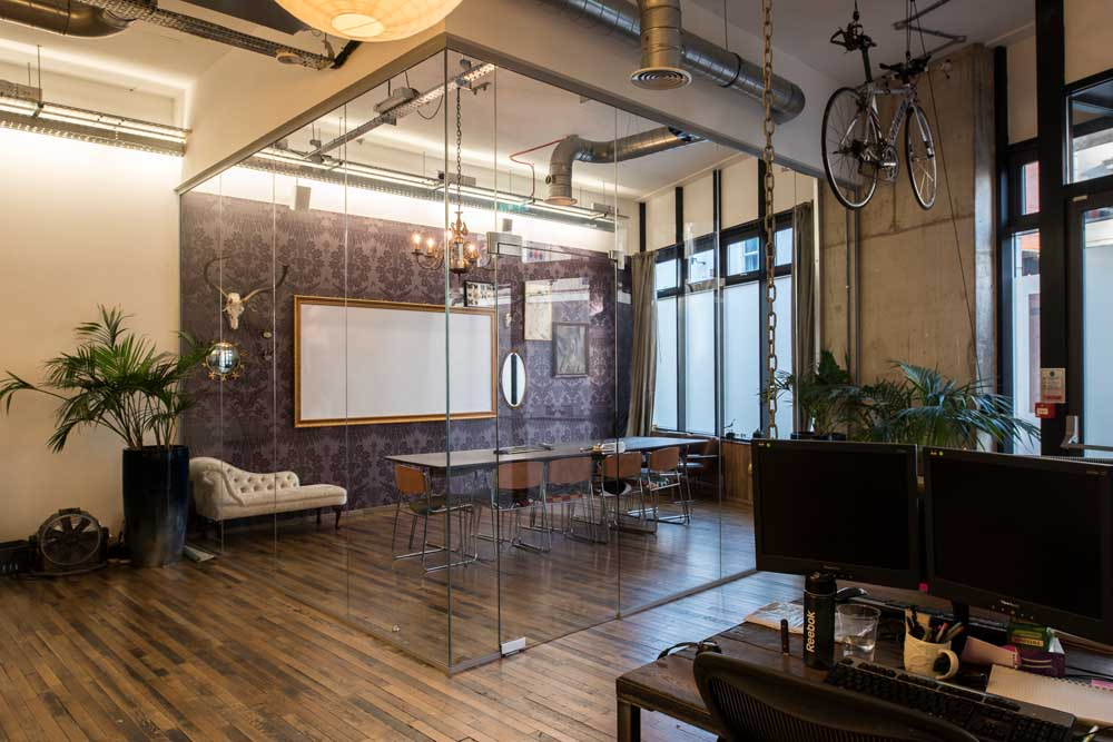 meeting room divided off in office complex by partions from applied workplace